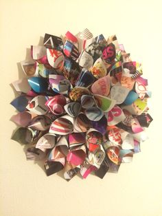 DIY wall art made from a magazine. Rolled paper, stapled to stay and glued to foam board.