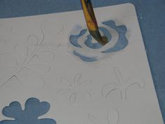 Kids Art: Stencil Sand Art  Would be great to different beach stencils and have the kids create a beach scene with sand.
