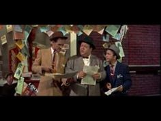 From Guys and Dolls: Fugue for Tinhorns. The movie as a whole is a mixed bag (Marlon Brando can't sing for beans), but this song is fantastic! And I love horse racing, so it makes me happy.