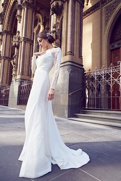 """Throwing a modern reception in a loft or restaurant? This Karen Willis Holmes gown features fashion-forward illusion lace panels (Style """"Emmy"""").Check out more gorgeous dresses in our gown gallery!Photo courtesy of designer"""