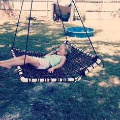 6. Enjoy cozy outdoor time with this swing made with weaved rope and pvc tubes.