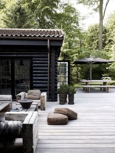 Black & grey colors and nice outdoor furniture for summer cottage