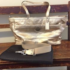 Coach Diaper travel bag preloved, auth patent gold Coach diaper bag. Comes with changing pad & removable strap.  There are minor scuffs here & there.  Interior is in great shape & is more of a satiny chocolate brown than the pics show. Bag has 1 pocket in the front, 1 zippered outer pocket on back, 2 side pockets. Inside is divided in 2 sections. Each side has a zippered pocket along with sewn in storage pockets. A friend got this bag at the same time just for toting her stuff Coach Bags…