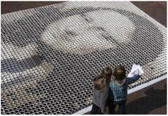 Portrait of the Mona Lisa created using 3,604 cups of coffee and 564 pints of milk for colouring.