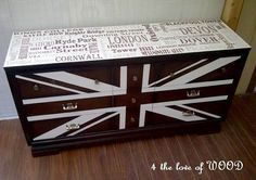 union jack painted with wood finish underneath peeking through.  Subway word art on top using same method!