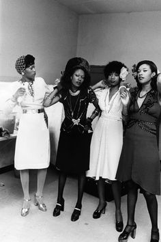 The Pointer Sisters do a few last-minute touch ups before hitting the stage in 1973. They were photographed by Pulitzer-Prize winning photographer Moneta Sleet Jr. Photo via Ebony archives on Art.com.