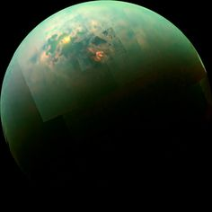 Sunlit Seas Shine on the Surface of Saturn's Largest Moon Titan - The image captured by the Cassini Spacecraft reveals a glimmer of sun reflecting off the surface of the two large polar hydrocarbon seas of Titan- Kraken Mare and Ligeia Mare.  Image Credit: NASA/JPL-Caltech/University of Arizona/University of Idaho. Click through to read more