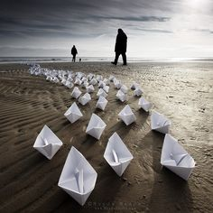 paper boats on a beach