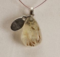Real Dandelion Seeds in resin pendant with Wish by RiverSilverWolf