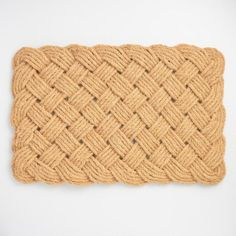 Crafted of natural coconut coir bristles, our chunky rope doormat has a knotted texture that provides a fine welcome to foot traffic. World Market &30
