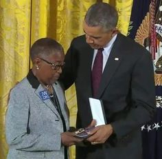 Sister Constanza Wilson accepted the medal of valor for her grandson. It was a great testimony to the nation that she wore our symbol JW.org - Post a Photo - World News Forum