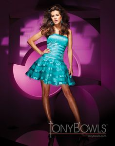 Strapless tulle and satin short A-line dress with hand-beaded appliqués, ruched bust line, satin banding on midriff and circle skirt. Detachable straps included.