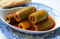 Coosa mehshee - a Lebanese dish of ground meat, tomato, and rice stuffed yellow squash