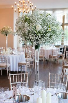 Bristol Florists, The Wilde Bunch at Coombe Lodge. These Gypsophila and white Ranunculus tall vase designs were the perfect compliment to the snow outside. Lodge Wedding, Wedding Dinner, Wedding Table, Wedding Ideas, Reception Decorations, Wedding Centerpieces, Table Decorations, White Ranunculus, Winter Wedding Flowers