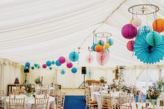 Whimsical colorful wedding tent decor! | Sophie & Lawrence's Retro Fun Family Wedding via @onefabday