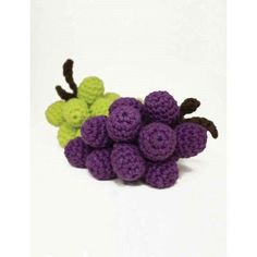 "Grapes Free Easy Toy Crochet Pattern. Skill Level: Easy Measurements: Approx 9½"" (24 cm) long x 1¾"" (4.5 cm) diameter. These crocheted grapes look almost good enough to eat! Crocheted in Lily Sugar 'n Cream yarn. Free Pattern More Patterns Like This!"