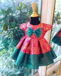 Brocade Dress for Girls - A dual color and design brocade dress with box pleats and a cute bow on the bodice. Girls Frock Design, Kids Frocks Design, Baby Frocks Designs, Baby Dress Design, Kids Dress Wear, Kids Gown, Kids Wear, Baby Girl Party Dresses, Dresses Kids Girl