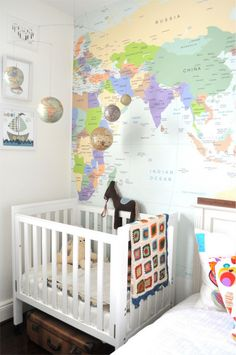 Cot: 'Turin' by Growtime - perfect for small rooms appts.  Cot blanket: handmade, purchased in Bali.  World map decal: The Wall Sticker Company.  Globe mobile: ABC Home, New York City.  Boat wall art: Mathilda's Market.