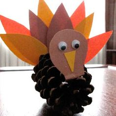Such an easy kids' craft for Thanksgiving! Precious Pine Cone Turkey | AllFreeKidsCrafts.com