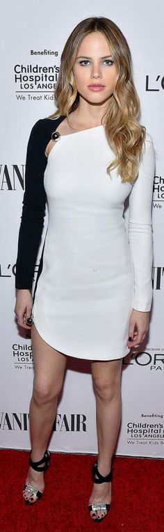 Who made Halston Sage's black sandals and white long sleeve dress?