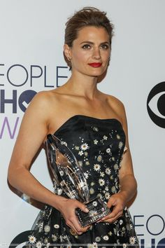 """Stana Katic at the People's Choice Awards on January 7, 2015. She's holding the award she won for """"Favorite Crime Drama TV Actress."""""""