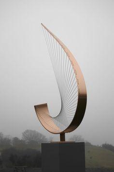 by Thomas Joynes titled: 'Crescent (Abstract Curved Stringed Garden statue)'. Steel Sculpture, Bronze Sculpture, Abstract Sculpture, Textile Sculpture, Metal Art Sculpture, Statue Art, Arte Linear, Contemporary Sculpture, Contemporary Garden