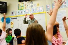Chief Master Sgt. Jose Barraza, 12th Air Force (Air Forces Southern) command chief, visits a second grade class at Craycroft Elementary School, Tucson, Ariz., Feb. 10, 2016, during Love of Reading Week. During his visit, Barraza read to multiple classes and talked with the students about the importance of reading and education.
