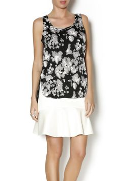 looking for the perfectblouse to take you from day to night? This sleeveless floral blouse can be worn to work under a blazer then ditch the blazer for a night out and make a statement in this blouse with exposed back zipper.   Floral High Low Blouse by J HARPER. Clothing - Tops - Sleeveless Manhattan, New York City
