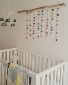 Modern gender neutral baby room. #trianglequilt #feltballs @vintagekitchn @splendidsundries @emma_cvb