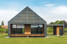 """The house is fitted with a """"glass shield"""", which wraps around the roof and all façades of the building, protecting its wooden construction against rain and wind. The glass shield is made of recycled glass and in principle is indestructible. The shield is one continuous surface, unbroken by vent pipes – again ensuring extended service life by avoiding leakage from joints. © Jesper Ray"""