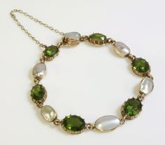 An Edwardian gold blister pearl and green paste set bracelet, For sale by auction 25th November 2014