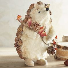 "With handcrafted pinecone ""quills,"" our handsome hedgehog wouldn't dream of arriving at a party empty-handed. He carries a colorful fall garland and will add charm to your table, mantel or tablescape."