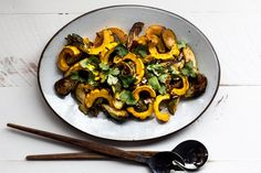 Miso-Harissa Delicata Squash and Brussels Sprouts Salad: The miso-harissa dressing that brings this winter squash and Brussels sprout salad together is lovely year round. Toasted almonds garnish the dish with wonderful texture and crunch. Brussel Sprout Salad, Sprouts Salad, Brussels Sprouts, Healthy Thanksgiving Recipes, Vegetarian Recipes, Thanksgiving Sides, Detox Recipes, Salad Recipes, Roasted Vegetables