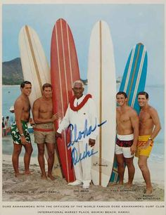 Signed picture of Duke Kahanamoku with officers of his surf club on Waikiki Beach. Used for a Pan Am promotional flier. From the collection of Mark Blackburn.