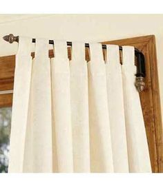 What if you did something like this? The arm swings away from the French door so you don't have to slide any curtains out of the way to open up for light