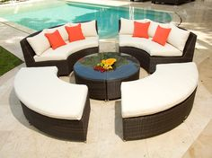 This Spacious Brown Wicker Patio Furniture Boasts Colorful Lime Green  Cushions Paired With Bold Red And Orange Throw Pillows. A Round Table With  A U2026