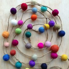 Online Find of the Day.... Felt Ball Garland.... loooovely to top off a fun, white and bright nursery
