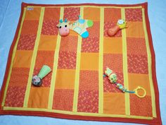 patchwork quilt with snap on/off baby toys