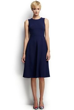 "Lands' End Women's Tall Ponté A-line Dress in (Midnight Indigo); FEATURES:  Structured ponté knit Neckline dips to a V in back Flattering flared skirt Side pockets Falls to the knee Shoulder to hem lengths: Tall, 43"";  67% polyester/28% nylon/5% spandex. Machine wash. Imported"