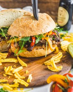 Cajun Steak Sandwich with Peppers and Onions - Britney Breaks Bread Beef Steak Recipes, Cajun Recipes, Sauteed Peppers And Onions, Cajun Salmon, Salmon Sandwich, Remoulade Sauce, Cajun Dishes, Recipe Filing, Angus Beef