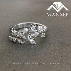 White gold marquis diamond wedding band.