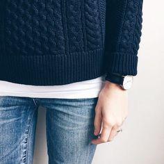 Navy. oversized sweater. white tee. denim. big watch.