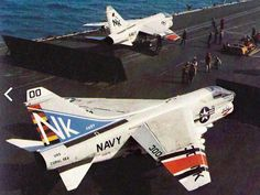 A-7E Corsair II's of VA-97 USN prepare to depart USS Coral Sea. The brightly coloured aircraft in the foreground is the Commanding Officer's assigned ride.
