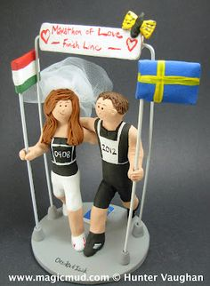 Sporting Athlete's Wedding Cake Topper  ...this sporting couple are true athletes....so they wanted a wedding cake topper that would reflect their love of marathon running!!... the beautiful bride is holding her native Hungarian flag while this very fit groom is brandishing his homeland Sweden's flag....$235 #run#marathon#jog#joggers#wedding #cake #toppers #pilot #airplane #custom #personalized #Groom #bride #anniversary #birthday#wedding_cake_toppers#cake_toppers#figurine#gift