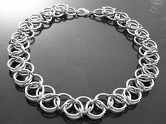 STAINLESS STEEL NECKLACES AND CHOKERS