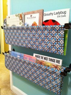 Fabric pocket book shelves using a double curtain rod - love it!