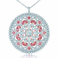 Pink and white diamonds enchant the eye in this pendant.
