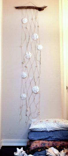 Sand Dollar hanging #coastalbedroomsdecorating