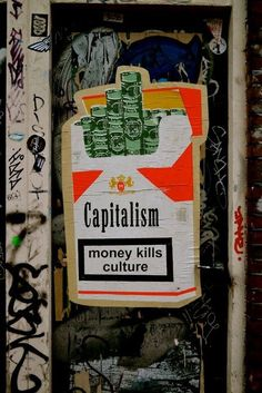 I love this photo because I think it perfectly depicts capitalism. EVERYTHING is about money. It's not about the well being of others, its not about the harmful effects of what someone is selling, its about money. Money is all that matters in capitalism. Arte Punk, Arte Hip Hop, Urbane Kunst, Political Art, Street Art Graffiti, Street Art Quotes, Land Art, Banksy, Urban Art