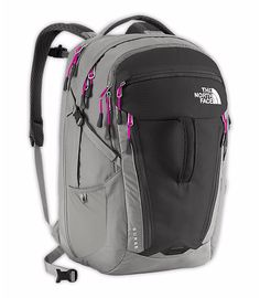 The North Face - Women's Surge backpack in grey/pink. Has a lay flat laptop sleeve for easy travel. Available on www.thenorthface.com